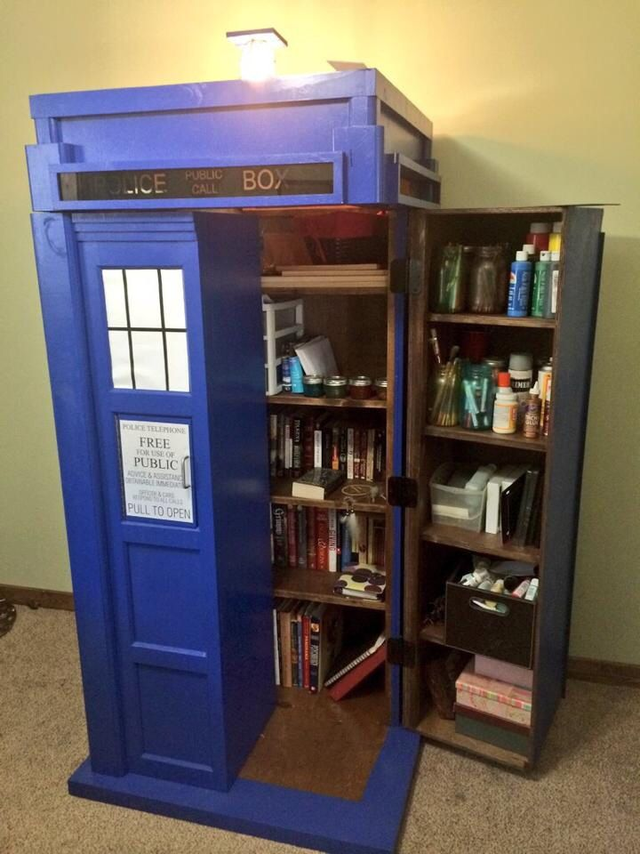 TARDIS bookshelf with working light! The best Christmas present ever for this Whovian. Dictor Who would be proud. The Wayward Pirate outdid himself :) More pics at www.facebook.com/waywardpiratewoodworking