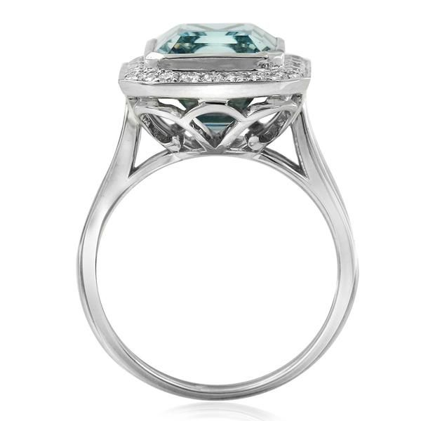 The luminescent Aura ring design by Gerard McCabe. Featuring a sparkling emerald cut aquamarine, bezel set and surrounded by brilliant white diamonds. Crafted in 18ct white gold. Allow 6 weeks to custom make this ring for your finger size.