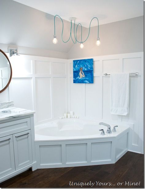 Custom trimed corner jetted tub, board and batten surround