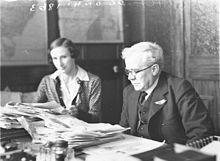 Albert Edward Grace, the head of Grace Bros department store and his secretary in his office