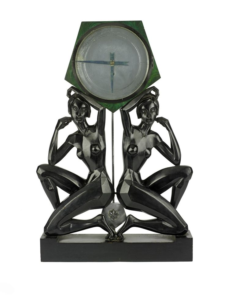Clock with a case supported by carved wooden female figures, cubist in style, the hours marked by concentric circular lines and hands in the form of thunder bolts, possibly associated with Turner Lord: British, 1920 - 1939