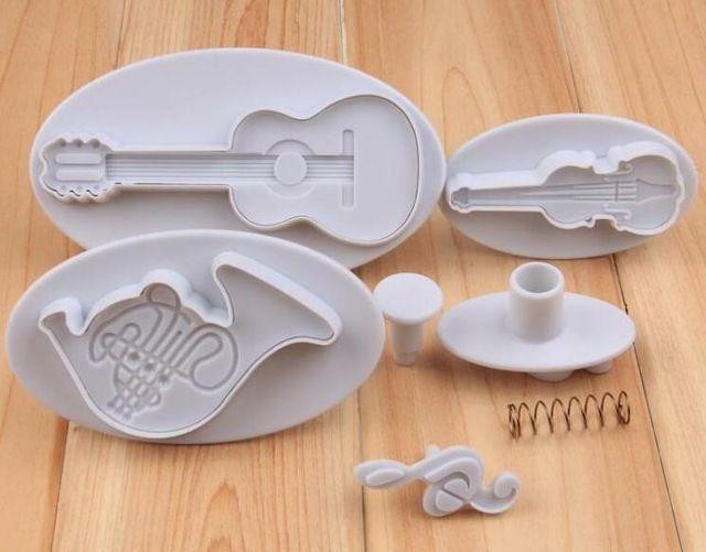 4.78€ Herramientas de la torta 1 Unidades 4 unids instrumento musical plástico torta del molde del cortador fondant cake Decorating Pasta de Goma molde guita música nota