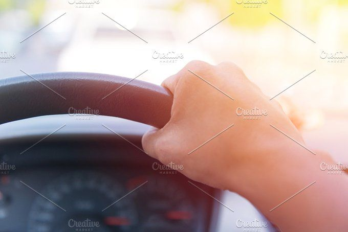 Hands of a driver on road. by Casanowe-studio on @creativemarket