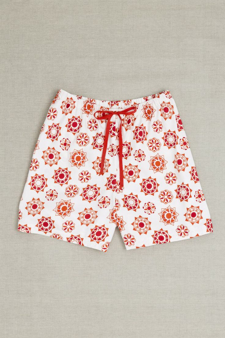 Moonbird classic shorts have an elastic waistband and cotton drawstring for an adjustable fit. Our comfortable loose shorts are made from beautifully soft 100% GOTS certified woven organic cotton and are hand screen printed with Desert Sun print. Shorts have french seams and cotton care labels for extra comfort. Cotton brand label can also be used as a hanging loop. Printed and assembled in Jaipur, India in a Fair Trade accredited facility. $50 AUD