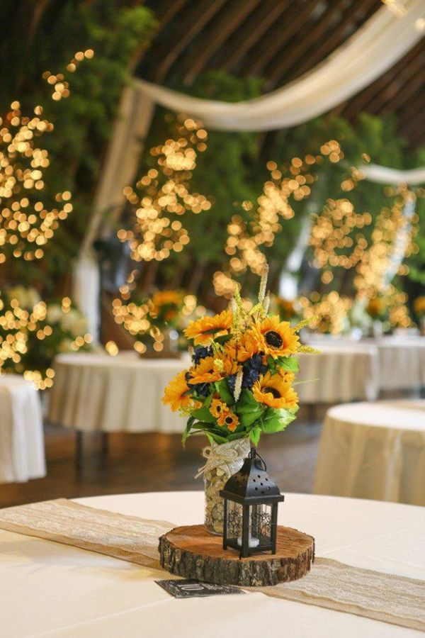 A rustic wedding with a beautiful barn and a sunflower theme centerpiece