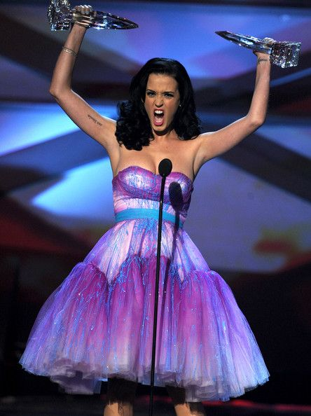 Katy Perry Singer Katy Perry aka Katy Brand accepts the Favorite Female Artist and Favorite Pop Artist awards onstage during the 2011 People...