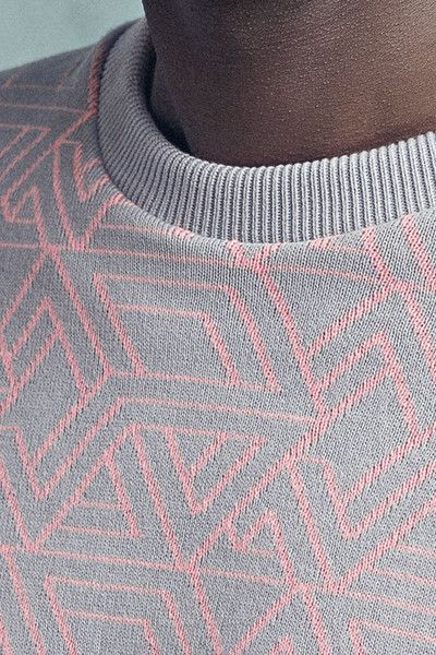 Soft-touch knit with all over jacquard Round neckAbove - elbow sleeves Ribbed cuffs and hemRegular fit 100% Cotton