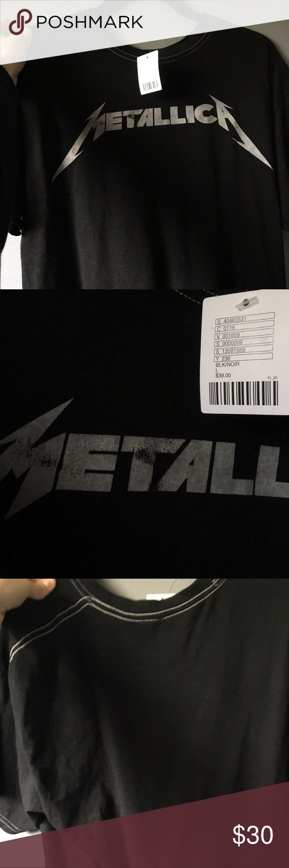 Urban Outfitters Metallica Band Tee Brand new WITH tags Band Tee. It fits oversized and the stitching is white. Some fading on the letters but it came that way. I am open to trades or offers Urban Outfitters Tops Tees - Short Sleeve