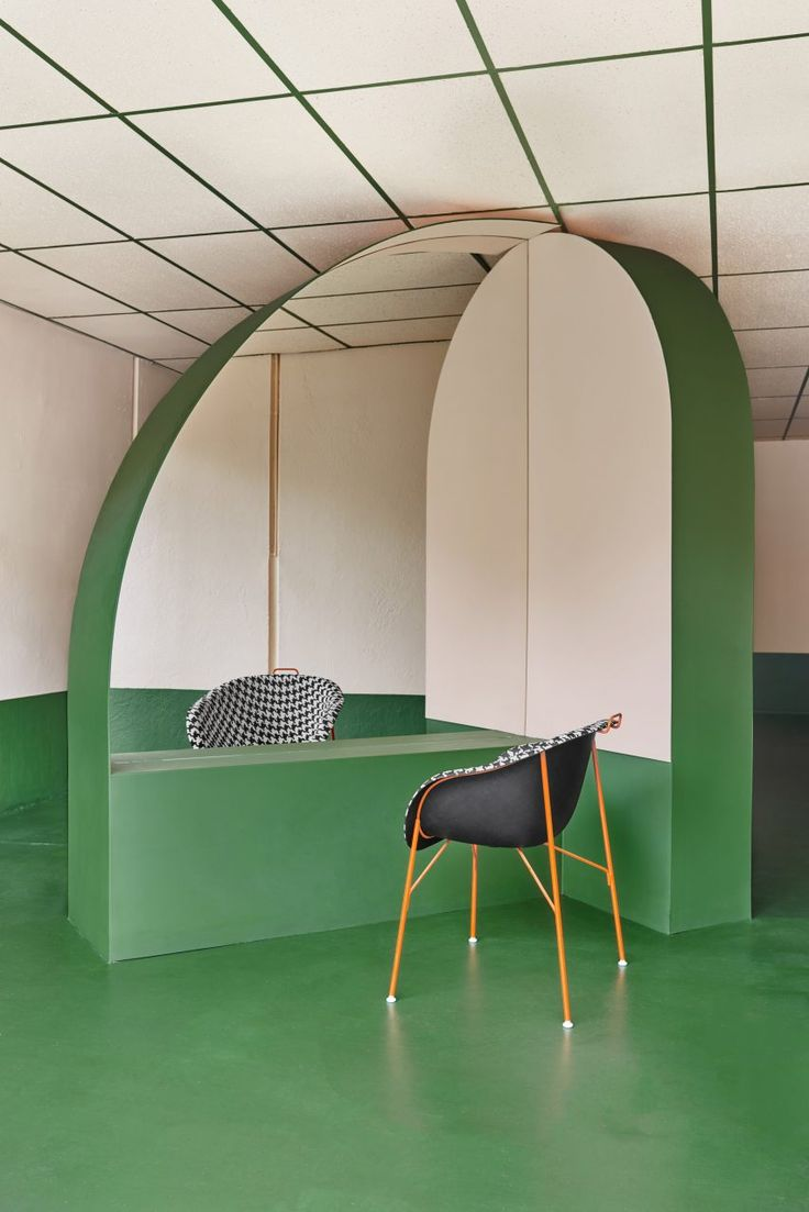 The bold colours and geometric shapes used throughout this hair salon in Melbourne are based on the works of postmodernist designer Ettore Sottsass