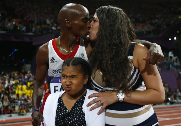 Farah kisses his wife, Tania, daughter Rihanna making a duck face.