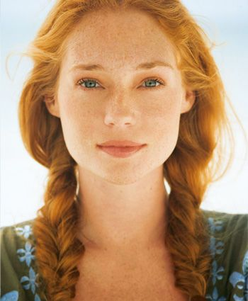 red... when I was younger, I wanted to be a freckled red head with green eyes. lol I really did.