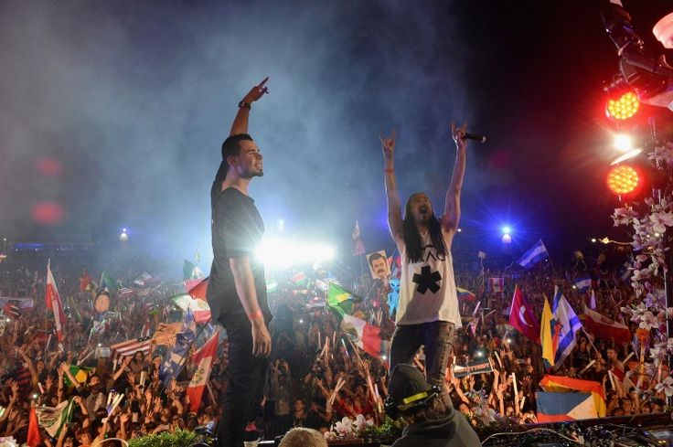 Turn it up! Afrojack and Steve Aoki, aka Afroki, pump up the crowd at the 2013 TomorrowWorld electronic music festival on Sept. 28 in Fairburn, Ga.�