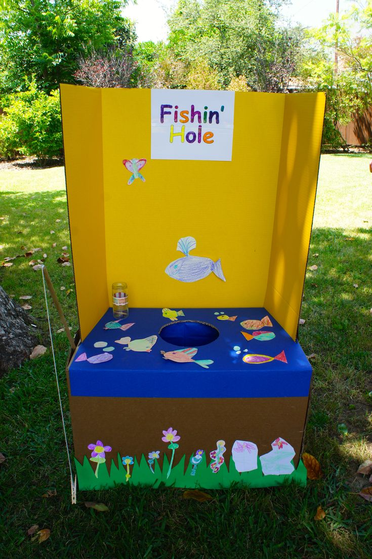 Fishing game for carnival birthday party.  I am sure I could make something like this! wonder if instead of someone having to put the treat on, if you could use ziplocks with some kind of magnet....