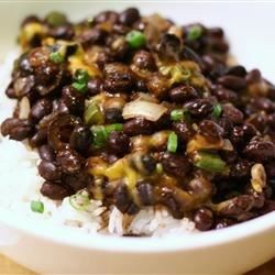 Black, red or pinto beans are baked with jalapeno chile peppers and spices, and served atop hot brown rice.