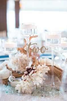 Yacht club ocean-inspired table decor: http://www.stylemepretty.com/florida-weddings/naples-fl/2015/08/19/romantic-yacht-club-wedding/   Photography: Hunter Ryan Photo - http://hunterryanphoto.com/