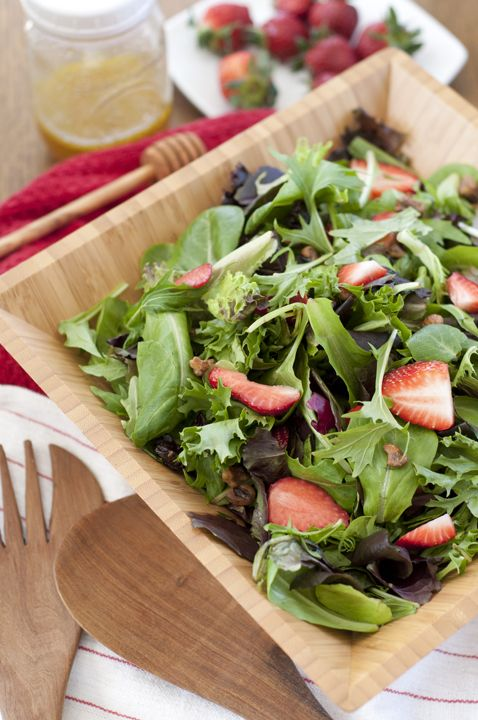 Strawberry Arugula Salad with Honey Lime Vinaigrette recipe is a healthy green salad loaded with fresh fruit & nuts. It is great for picnics & captures the essence of summer!