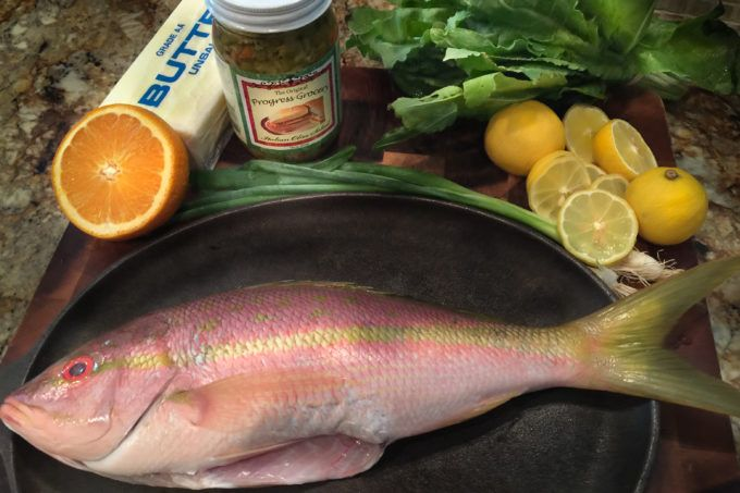 BAKED YELLOWTAIL SNAPPER WITH HERBS, LEMONS, AND OLIVES - Colorful yellowtail snapper combine with equally colorful ingredients. - BEFORE