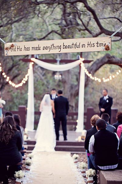 Hang your favorite quote or Bible verse at the entrance to your aisle for a sentimental touch.