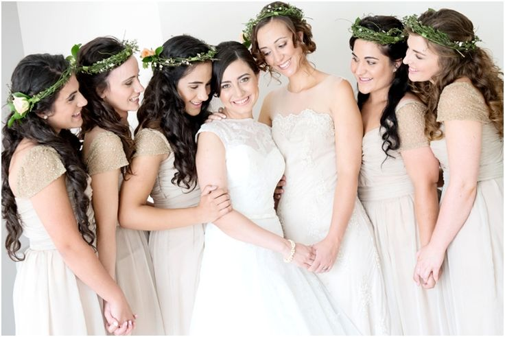 My bridesmaids in their beautiful beige dresses and flower crowns