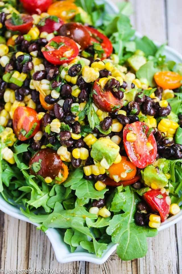 Chipotle Black Bean Tomato Corn Avocado Salad - serve as a dip or on a bed of baby arugula for a complete salad - perfect for summer barbecues and picnics! ~ http://jeanetteshealthyliving.com