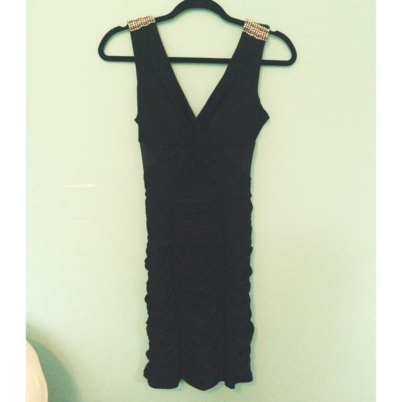 Black Homecoming Dress Black tight fitting dress! Has built in bra, and was worn once!! Sequin Hearts Dresses