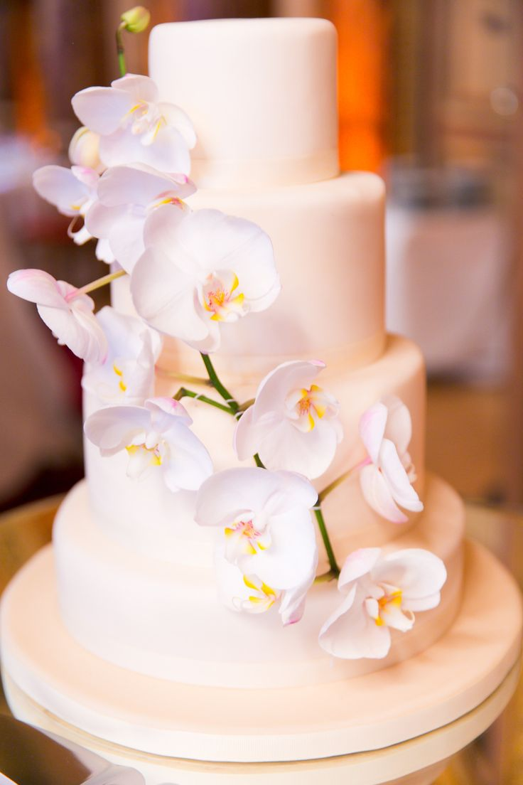 #WeddingCake | Orchids | One and Only Paris Photography | See the wedding on #SMP Weddings: http://www.stylemepretty.com/destination-weddings/2013/12/06/paris-wedding-from-one-and-only-paris-photography-2/