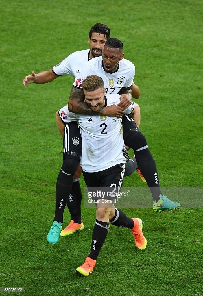 #EURO2016 Shkodran Mustafi of Germany celebrates scoring his team's first goal with his team mate Jerome Boateng and Sami Khedira during the UEFA EURO 2016 Group C match between Germany and Ukraine at Stade Pierre-Mauroy on June 12, 2016 in Lille, France.