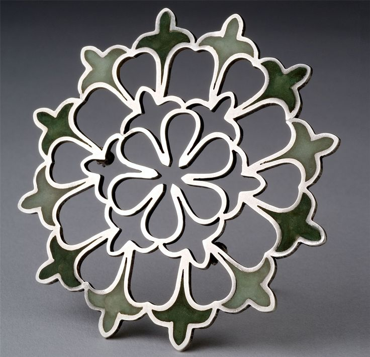 Brooch | Janet Huddie. 'Cathedral Window' Sterling silver and hand-dyed translucent polymer clay.