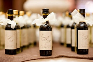 Wine Bottle Favors. I hope I am not poor when I get married because ideas like this won't be able to happen.