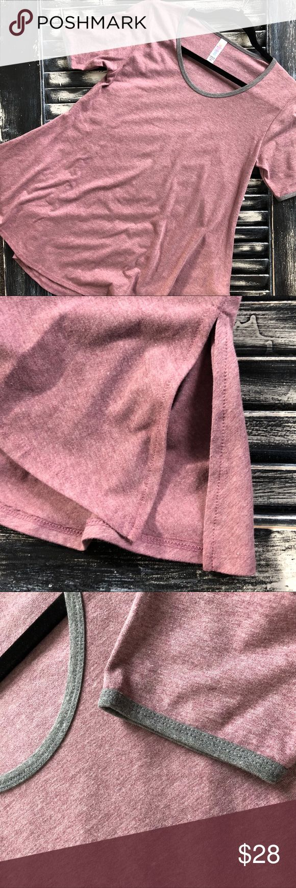 🏹❤️ Perfect T Ringer | LuLaRoe A-line Flowing NWT🏷 Gray ringer detailing on sleeves and neckline.  LuLaRoe's Perfect T boasts a fun swing shape complimented by flirty side slits and a flattering half-sleeve that makes this simple, comfortable top the star of any outfit. Pair it with any of LuLaRoe's skirts and leggings for a look that can't be ignored!  Happy Valentines Day LuLaRoe Tops Tees - Short Sleeve
