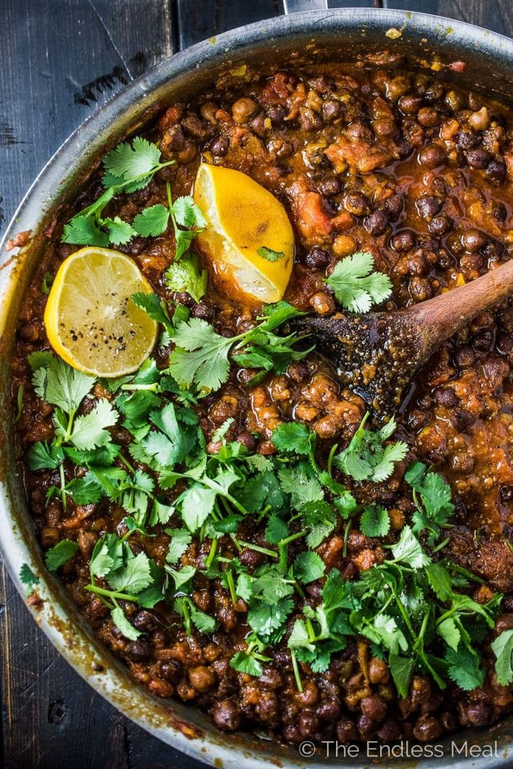 This delicious Black Chana Masala is an easy to make chickpea curry made with black chickpeas. It's bursting with flavor and is a healthy Meatless Monday vegan dinner recipe. If you're short on time you can sub regular canned white chickpeas. They're delicious, too!