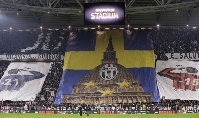 Juventus supporters display banner of Turin landmark Mole Antonelliana before match against AC Milan in Serie A soccer match in Turin