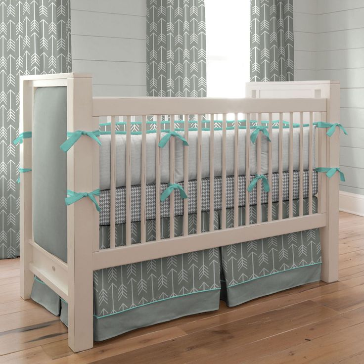 "Crib Dust Ruffle in Gray and Teal Arrow by Carousel Designs.  Think outside the box and get creative! Get your crib picture perfect with our box-pleat crib skirt including a 4-inch trim and accent. Finished length approximately 13-14 inches. Fits standard cribs using mattresses measuring approximately 28"" x 52"". Dry clean only."