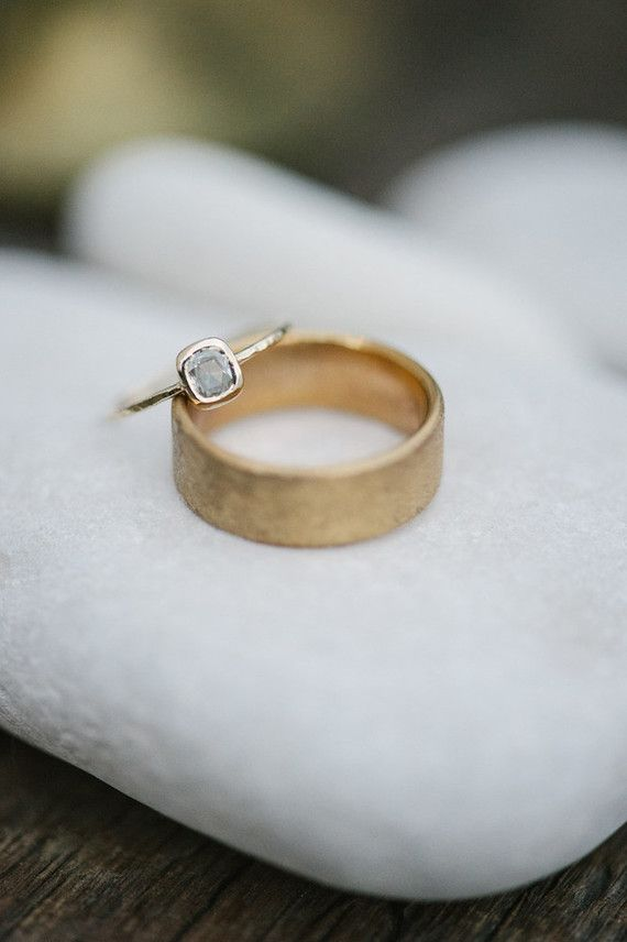 These modern wedding rings are good starting points for your bespoke designs. Particularly like the idea of a distressed gold band.