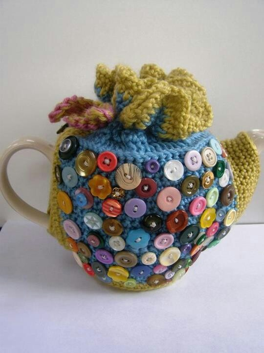 Crochet tea cozy with buttons