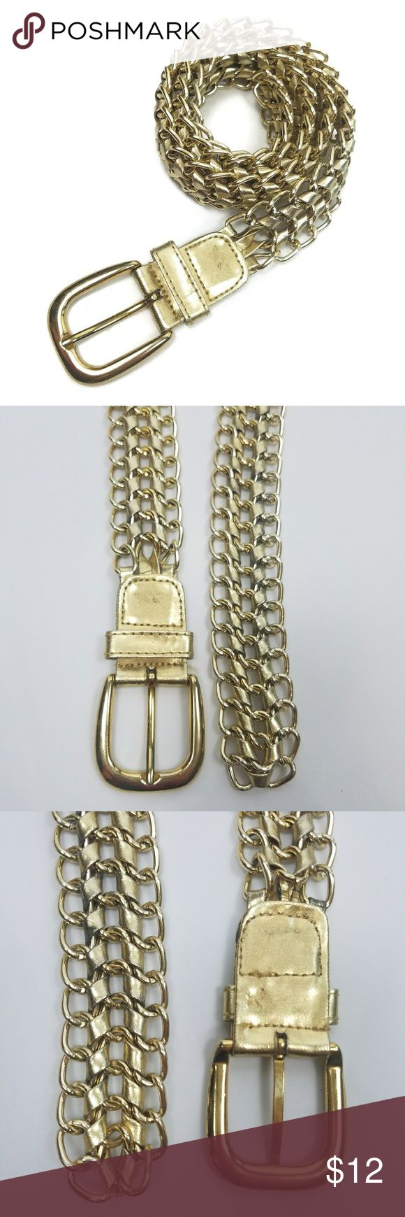 "Vintage Chain Metal Gold Tone Faux Leather Belt Vintage chain and faux leather belt. Fits up to 33"" waist with 2"" left at the end. In good vintage condition. Discoloration and cracking to the faux leather. One thread ripping out on buckle. Light wear to the metal.  Measurements are approximate. Width: 1"" Total length: 35"" (not counting buckle) Unbranded Accessories Belts"