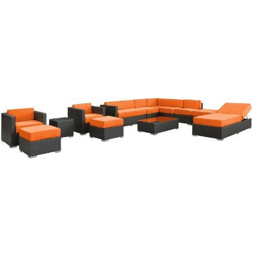 East End Imports Fusion Outdoor Rattan 12 Piece Set in Espresso with Orange Cushions by East End Imports. $6901.14. • All Weather Synthetic Rattan Weave • Powder Coated Aluminum Frame • Water & UV Resistant • Machine Washable Cushion Covers • Easy To Clean Tempered Glass Top • Ships Pre-Assembled • Item Ships in 2 - 3 Weeks. Harmonious positioning lends grace to every gathering with this sprawling outdoor sectional set. Commingle as participants contribute individua...