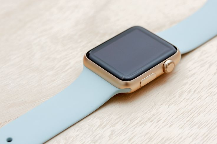 Apple Watch Sport Gold Case with Turquoise Sport Band.