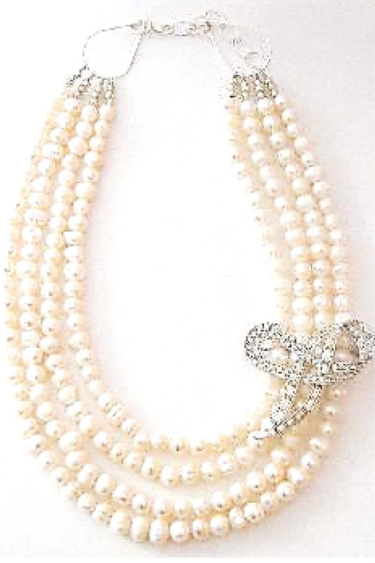 White freshwater pearl & Vintage brooch necklace.  One-of-a-kind statement necklace handmade with white freshwater pearls paired with vintage brooch $249,00. #statementnecklaces#necklaces#freshwaterpearl#handmadenecklace
