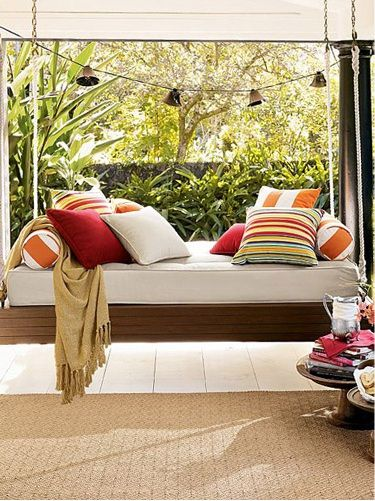 Love this swinging bench. It's more like a couch or day bed.