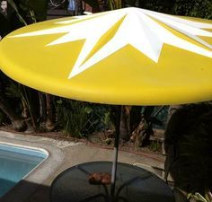 Image result for mid century modern iron outdoor umbrellas