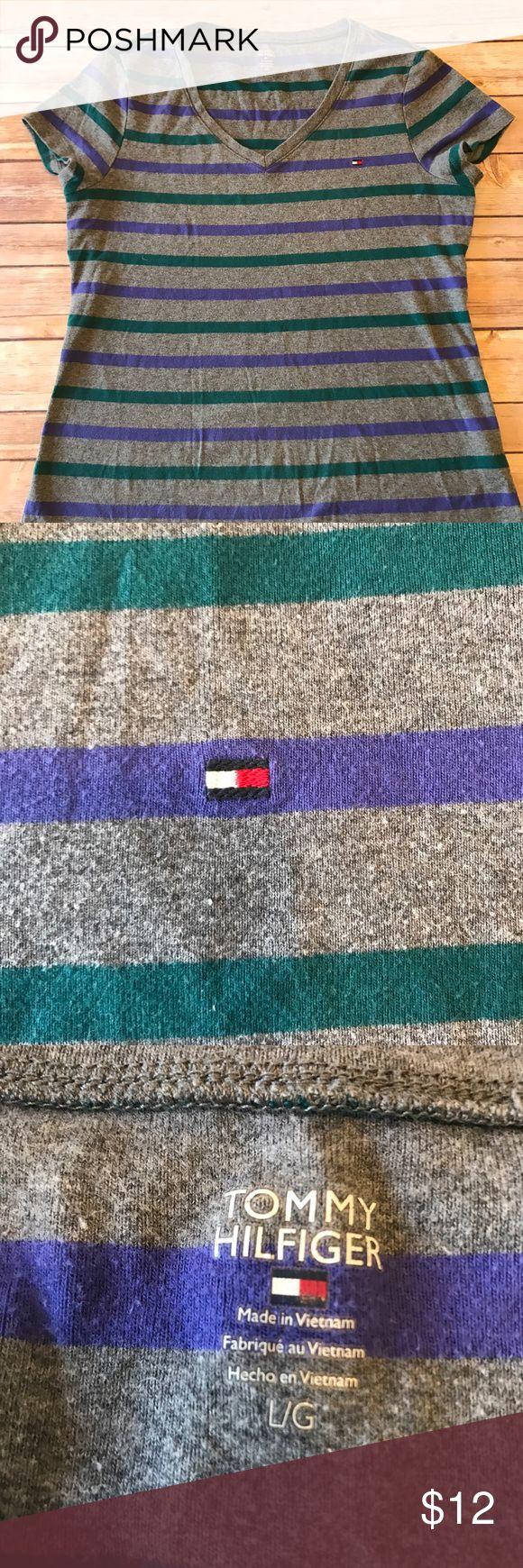 Tommy Hilfiger Women's V- Neck T- Shirt Tommy Hilfiger Women's V- Neck T- Shirt Short Sleeve Stripes Shirt  •VNeck Shirt •Striped •tommy Hillfiger Symbol on shirt •Grey/Purple/Green •Tshirt •Soft Tommy Hilfiger Tops Tees - Short Sleeve