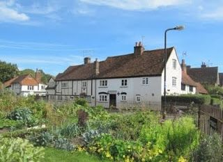 At the end of this street and opposite a row of small Chesham, UK, Whitewashed cottages with impressive kitchen gardens/allotments. These were once the workhouse gardens.