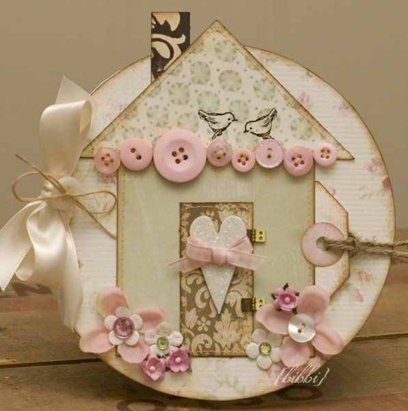 From the circular base to the shabby chic details and vintage inspired palette, there's much to love about this darling card. #card #scrapbooking #paper #crafts #buttons #pink #ribbon #hearts #birds #house #shabby #chic #romantic