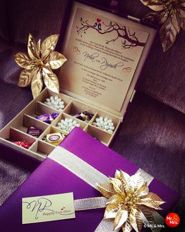 Wedding Invitations - Purple and Gold Wedding Invitation | WedMeGood | Beautiful Purple Invitation Box with a Gold Flower Motif and Assorted Chocolates #wedmegood #invitations #weddingcards #chocolates