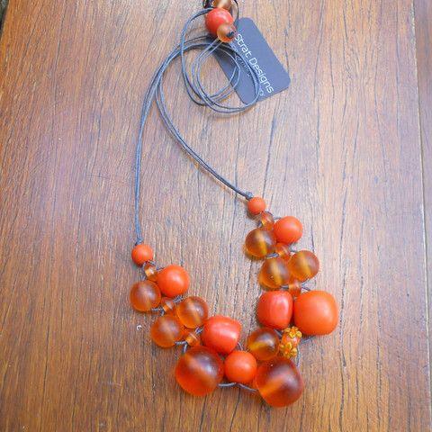 """Juicy jaffa orange """"Original Bubble Ball"""" necklace.  Fully adjustable, hand made on cotton cord with a delicious assortment of resin beads.  Lampwork glass feature bead."""