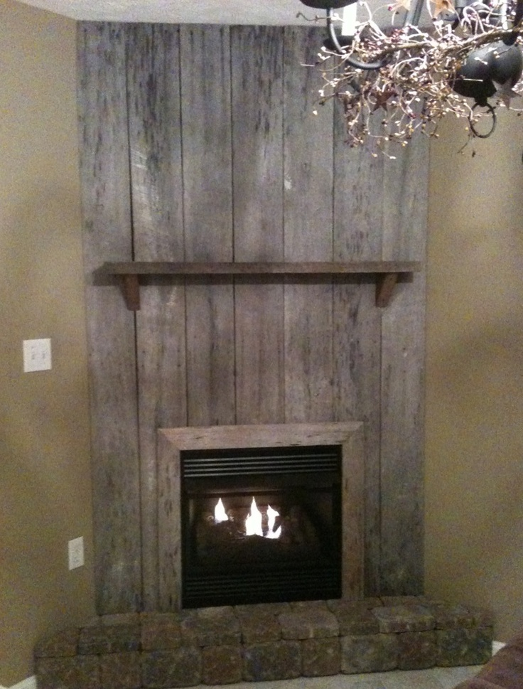 my awesome and beautiful fireplace made from barn wood love it