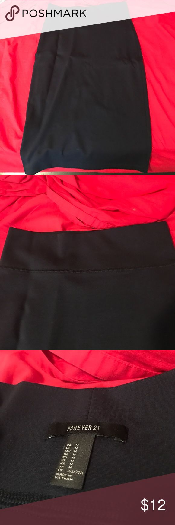Navy blue pencil skirt from forever 21! Never worn. Navy blue pencil skirt, super soft. Wrinkles are from being hung on a hanger and not moved! Forever 21 Skirts Pencil