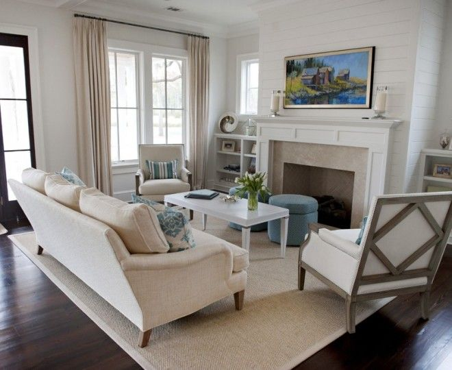Glamorous Shiplap  mode Atlanta Beach Style Living Room Inspiration with  beige curtains blue ottoman built in bookshelf built in bookshelves framed art neutral living