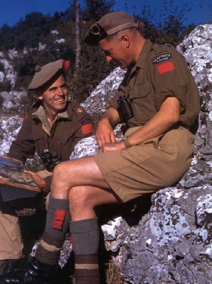 Original Pinner's caption: Lt-Col Bert Hoffmeister (in profile), wearing his Seaforth Highlander balmoral and shoulder flash in Sicily. Hoffmeister won a Distinguished Service Order for his actions in Sicily. Here he sits with a Major Wood, who wears a Black Watch Canada balmoral and shoulder flash, but oddly wears a 1st Division red patch. The Black Watch were part of Cdn 2nd Division. Perhaps he is temporarily attached. Your thoughts?
